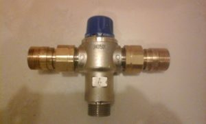 Look for a tempering valve in your hot water cupboard, attached to the cylinder's pipework.